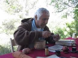 THe scribe Zechariya making kosher ink in Neot Kedumim from locally grown plants